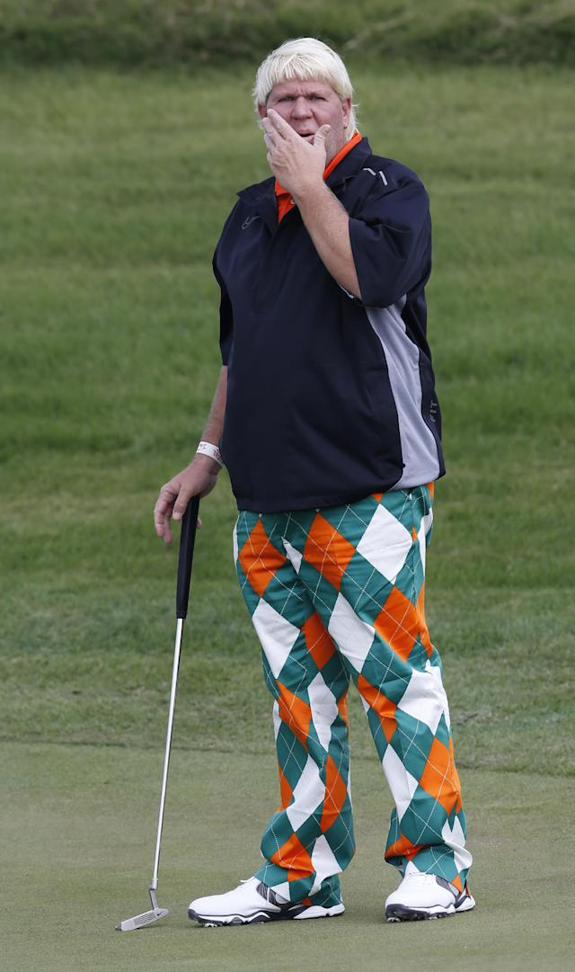 John Daly of the U.S. reads the green before putting at the 2nd green during a pro-am competition ahead of the Masters golf tournament at the Lake Malaren Golf Club in Shanghai, China, Wednesday, Oct. 23, 2013. The Shanghai Masters will begin on Oct. 24. (AP Photo/Eugene Hoshiko)