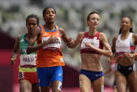 Sifan Hassan, of the Netherlands, crosses the finish line to win her heat of the women's 1,500-meters at the 2020 Summer Olympics, Monday, Aug. 2, 2021, in Tokyo. (AP Photo/Petr David Josek)