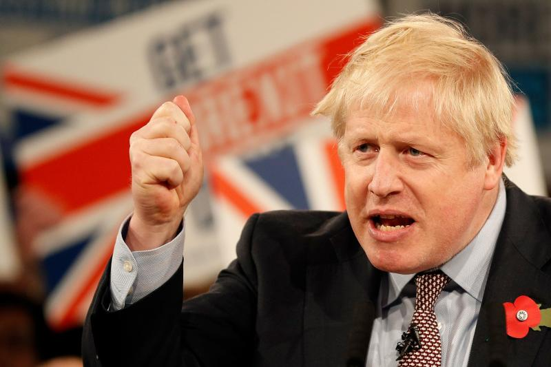 Britain's Prime Minister Boris Johnson speaks at the Conservative Party's General Election campaign launch, at the National Exhibition Centre (NEC) in Birmingham, central England, on November 6, 2019. - British Prime Minister Boris Johnson vowed Wednesday to get Brexit done by January and compared his Labour Party rival Jeremy Corbyn to Joseph Stalin in a strident launch to a tough pre-Christmas election campaign. The splintered country is entering its third general election in four years in search of a solution to a monumental crisis launched by the voters' decision in 2016 to file for a divorce from the European Union after nearly 50 years. (Photo by Adrian DENNIS / AFP) (Photo by ADRIAN DENNIS/AFP via Getty Images)