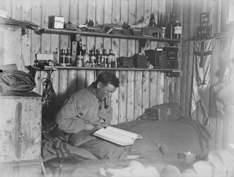 A self-portrait of scientist George Murray Levick smoking a pipe and reading on his bunk in the hut at Cape Adare, Antarctica (AFP Photo/)