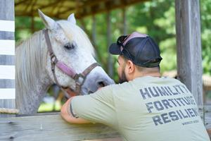 Spending time with horses during Warrior PATHH helps veterans learn to regulate their emotions.