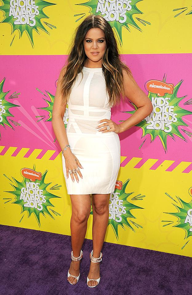 "Khloe Kardashian showed off her slimmed-down physique in a white frock, funky gold-and-white footwear, and lots of arm candy. Before hitting the purple carpet, she tweeted: ""Kids Choice Awards is today! Today will be fun :)"""