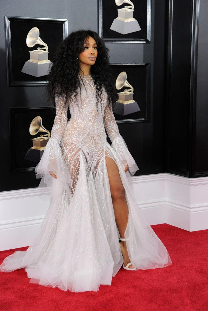 "<p>The. ""Good Days"" singer wowed on the 2018 Grammy red carpet wearing this unique, ethereal, fairy-esque gown by Atelier Versace, leaving fans in awe of absolutely striking beauty and fashion sense. (Image via Getty Images)</p>"