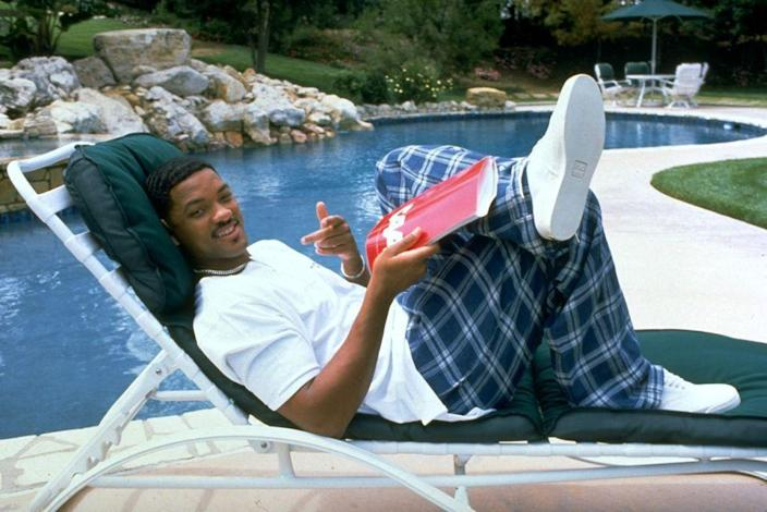 <p>Will Smith wears plaid pants to the pool in 1996.</p>