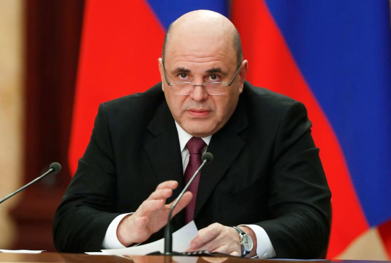 Russian Prime Minister Mikhail Mishustin speaks during a cabinet meeting on the State Television channels in Moscow, Russia, Wednesday, March 25, 2020. Putin has postponed a nationwide vote on proposed constitutional amendments that include a change that would allow him to seek another term in power. He also announced during a televised address to the nation that the government doesn't want Russians except those working in essential sectors to come to work next week. He said that stores, pharmacies and banks will stay open. (Dmitry Astakhov, Sputnik, Kremlin Pool Photo via AP)