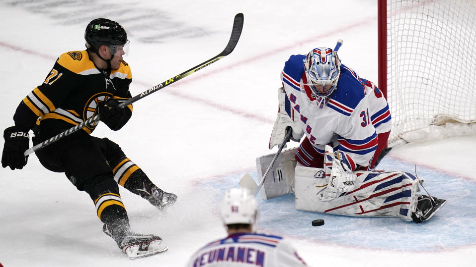 New York Rangers goaltender Igor Shesterkin (31) makes a save on a shot by Boston Bruins left wing Taylor Hall (71) during the third period of an NHL hockey game, Saturday, May 8, 2021, in Boston. (AP Photo/Charles Krupa)