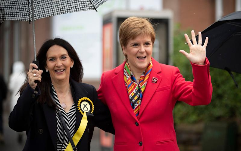 Margaret Ferrier, pictured on the campaign trail with Nicola Sturgeon in Glasgow last year - Jane Barlow/PA
