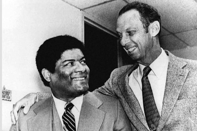 FILE - In this March 18, 1981, file photo, Washington Bullets' Wes Unseld, left, and team owner Abe Polling get together prior to a press conference in Landover, Md., where they announced that Unseld would retire as a player at the end of the 1980-81 season. Unseld, the Hall of Fame center who led Washington to its only NBA championship and was chosen one of the 50 greatest players in league history, died Tuesday, June 2, 2020, after a series of health issues, most recently pneumonia. He was 74. (AP Photo/Smith, File)