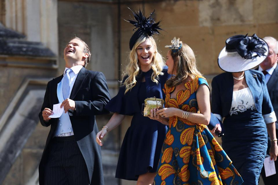 <p>The South Afrian, who dated Prince Harry, arrives in a navy blue look. <em>[Photo: PA]</em> </p>