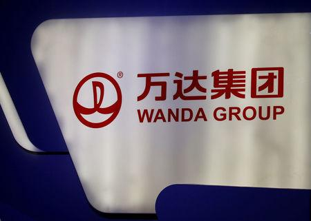 FILE PHOTO: A logo of Wanda Group is seen at a Wanda Group and China Union Pay joint news conference in Beijing