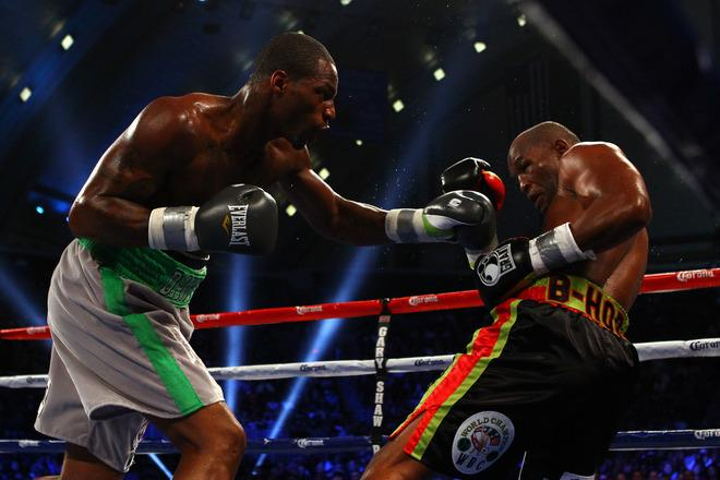 ATLANTIC CITY, NJ - APRIL 28:  Chad Dawson (grey trunks) throws a punch against Bernard Hopkins (black trunks) during their WBC & Ring Magazine Light Heavyweight Title fight at Boardwalk Hall Arena on April 28, 2012 in Atlantic City, New Jersey.  (Photo by Al Bello/Getty Images)
