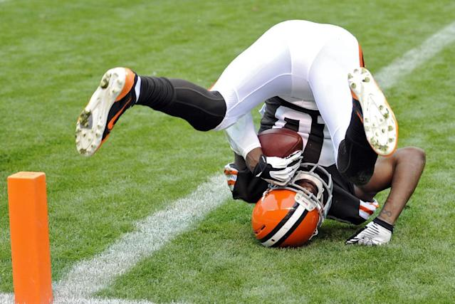 Cleveland Browns wide receiver Greg Little lands in the end zone after a 2-yard touchdown catch in the second quarter of an NFL football game against the Detroit Lions Sunday, Oct. 13, 2013 in Cleveland. (AP Photo/David Richard)