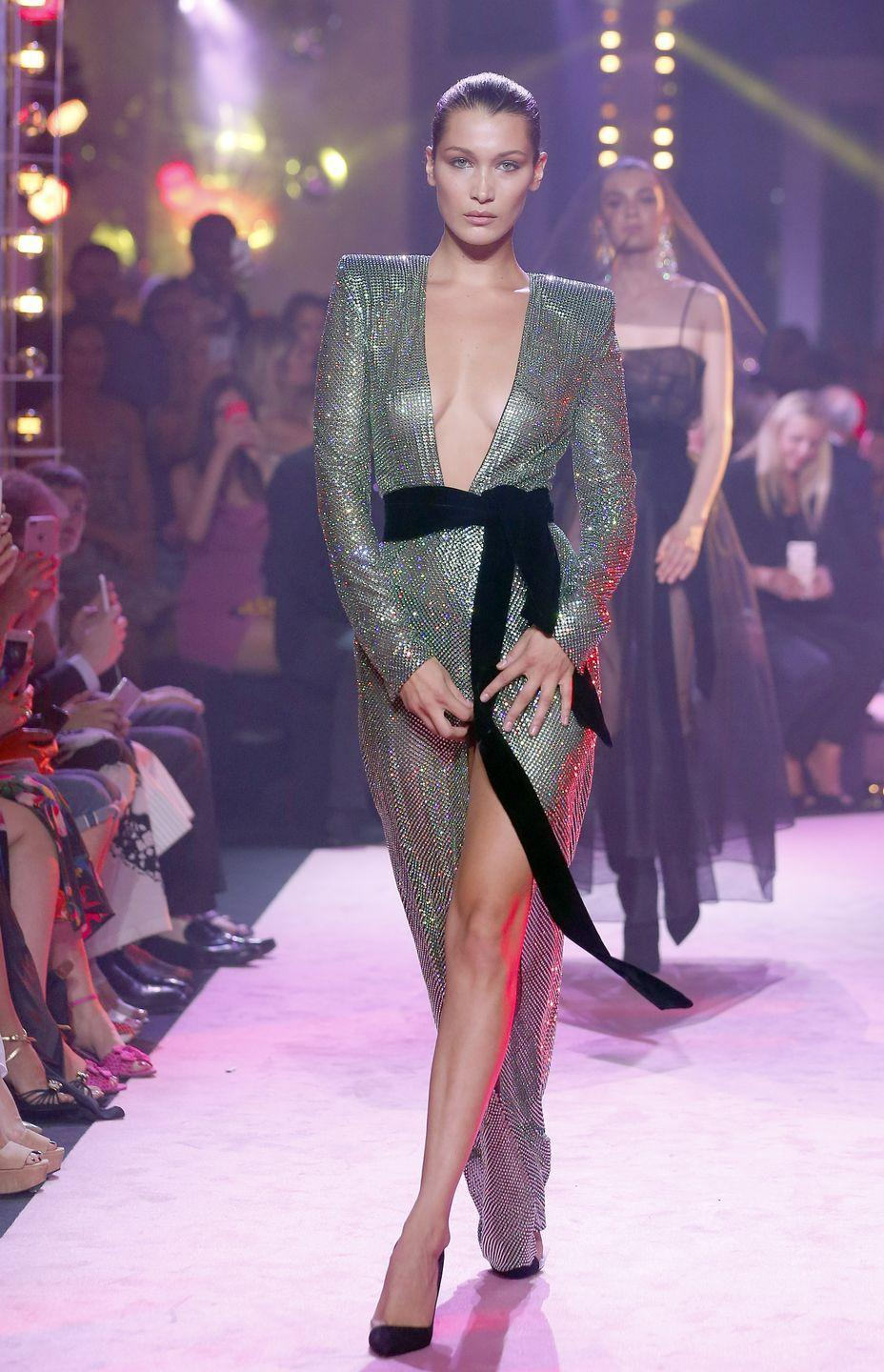 <p>Bella walks the Alexandre Vauthier runway show in a silver, plunge-neck gown during Paris' Haute Couture Fall/Winter 2018 fashion week, 4 July 2017</p>