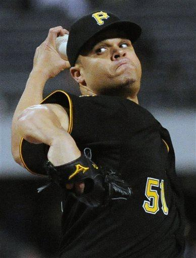 Pittsburgh Pirates starting pitcher Wandy Rodriguez throws against the Atlanta Braves in the fourth inning of a baseball game at PNC Park, Friday, April 19, 2013 in Pittsburgh. (AP Photo/John Heller)