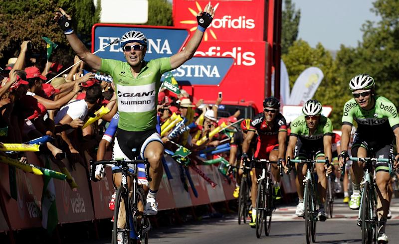 "Giant's German rider John Degenkolb (L) celebrates as he crosses the finish line to win the 5th stage of the 69th edition of ""La Vuelta"" Tour of Spain, from Priego de Cordoba to Ronda, on August 27, 2014"