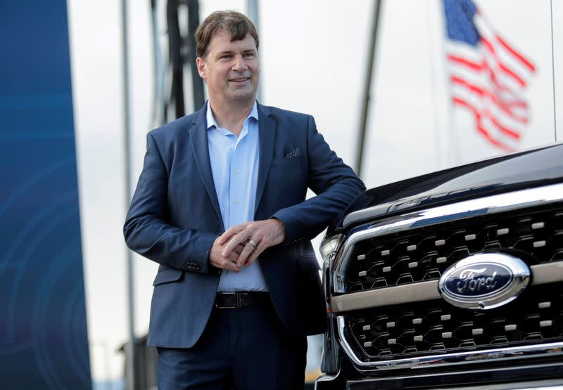 FILE PHOTO: Ford Motor Co. CEO Jim Farley poses next to a new 2021 Ford F-150 pickup truck at the Rouge Complex in Dearborn,Michigan