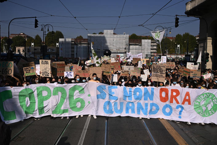"""Students hold a banner reading in Italian """"If not now, when?"""" as they march as part of the Fridays for Future climate movement's initiatives, in Turin, Italy, Friday, Sept. 24, 2021. (Marco Alpozzi/LaPresse Via AP)"""