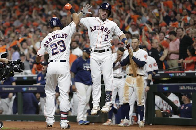 Houston Astros left fielder Michael Brantley (23) celebrates his solo homer against the Tampa Bay Rays with teammate Alex Bregman (2) during the eighth inning of Game 5 of a baseball American League Division Series in Houston, Thursday, Oct. 10, 2019. (AP Photo/Michael Wyke)