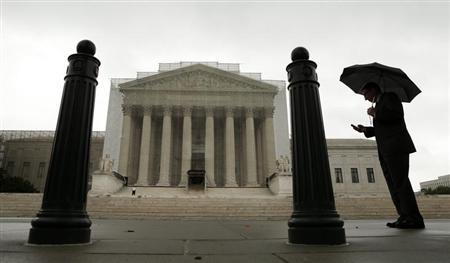 A man holds an umbrella outside the U..S. Supreme Court in Washington