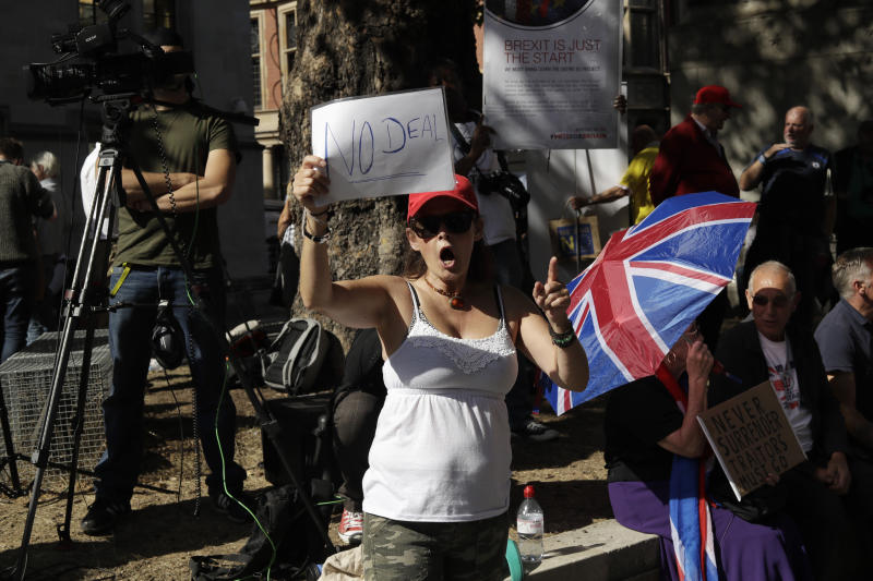 A Brexit supporter protests outside the Supreme Court in London, Thursday, Sept. 19, 2019. The Supreme Court is set to decide whether Prime Minister Boris Johnson broke the law when he suspended Parliament on Sept. 9, sending lawmakers home until Oct. 14 — just over two weeks before the U.K. is due to leave the European Union. (AP Photo/Matt Dunham)
