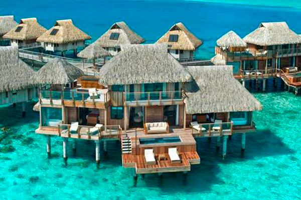 "<div class=""caption-credit""> Photo by: Hilton Bora Bora</div><div class=""caption-title"">1. Presidential Suite At Hilton Bora Bora In Nui, Tahiti</div><p>   Overwater bungalows are du riguer in French Polynesia, but not many can boast that they have two stories and an ultra-secluded position at the edge of a long pontoon. This two-bedroom suite offers all that, plus a private pool, an outdoor Jacuzzi, a dedicated in-room spa area, two living rooms and three bathrooms. Décor is traditional Tahitian, with natural woods and tropical prints. Nothing beats a morning cannonball into the multi-blue toned water, just off your sprawling deck. For more info, visit <a rel=""nofollow"" href=""http://www.bridalguide.com/planning/wedding-reception/fall-wedding-ideas"" target="""">hilton.com</a>. </p> <p>   <b>Related: <a rel=""nofollow"" href=""http://www.bridalguide.com/destination-weddings/wedding-caribbean/tahiti-honeymoon"" target="""">The Ultimate Tahiti Honeymoon</a></b> </p>"