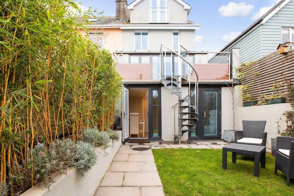 """<p>This rustic yet luxurious garden studio is an Airbnb in Devon that's sure to bring out the calm in you. A mini sanctuary (and probably the finest studio flat we've ever seen!), it features a lush garden for relaxing outside when the sun shines and making use of the BBQ.</p><p>Just a short walk from the centre of picturesque Salcombe, it's a peaceful spot to retire to after a day of exploring. The underfloor heating, walk-in shower and cute dining area make this Airbnb a wonderful home from home.</p><p><strong>Sleeps</strong>: 2</p><p><strong>Price per night:</strong> £80</p><p><strong>Why we love it:</strong> It's a boutique bolthole in one of the loveliest towns in Devon. The best Airbnbs aren't always about having an entire townhouse to yourself!</p><p><a class=""""link rapid-noclick-resp"""" href=""""https://www.airbnb.co.uk/rooms/plus/11054827/"""" rel=""""nofollow noopener"""" target=""""_blank"""" data-ylk=""""slk:SEE INSIDE"""">SEE INSIDE</a></p>"""