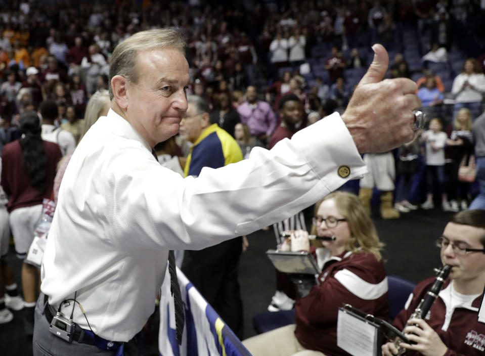 Mississippi State head coach Vic Schaefer gives a thumbs-up to the pep band as he leaves the court after an NCAA college basketball game against Kentucky at the women's Southeastern Conference tournament Friday, March 2, 2018, in Nashville, Tenn. Mississippi State won 81-58. Mississippi State won 81-58. (AP Photo/Mark Humphrey)