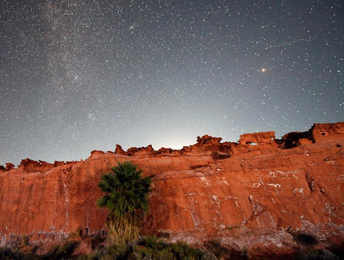 A Perseid meteor streaks across the sky above Gold Butte National Monument, Nevada on August 12, 2020. / Credit: Ethan Miller/Getty Images