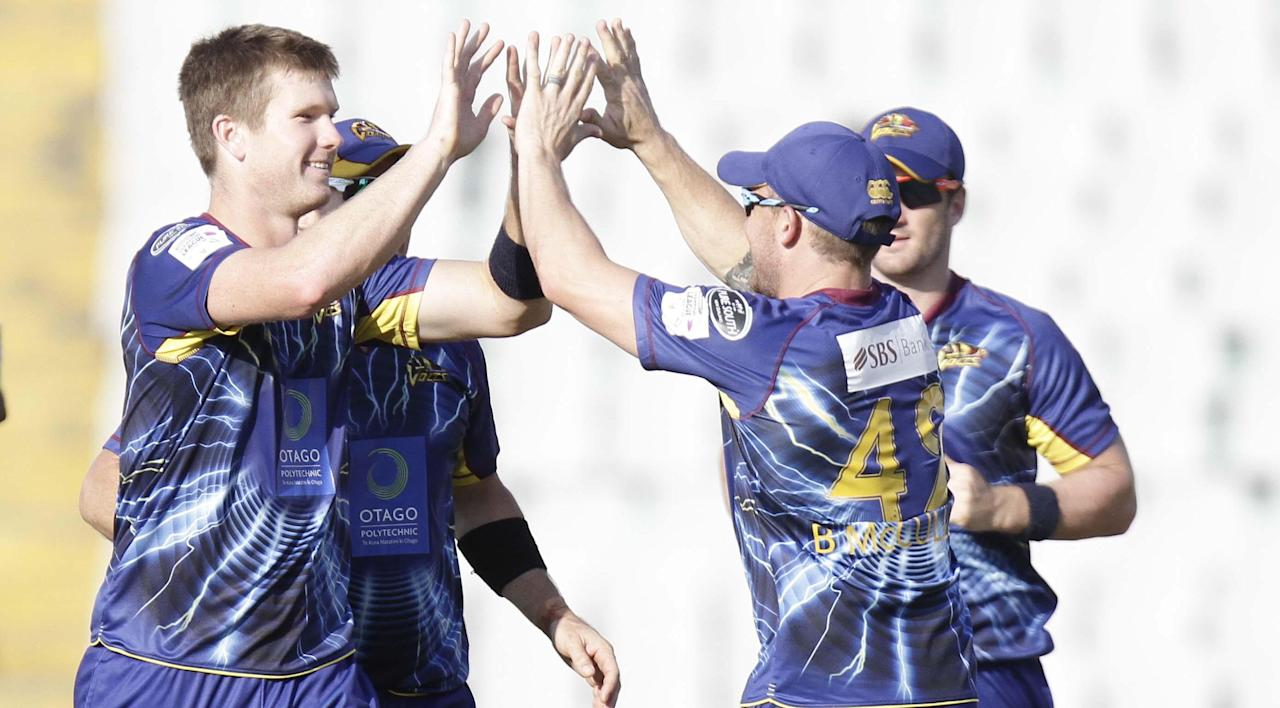 Otago player J D S NEESHAM after taking the wicket of Sangakara during the Champions League T20, 3rd Match between Kandurata Maroons and Otago Volts at Mohali stadium, Chandigarh on Sept. 18, 2013. (Photo: IANS)