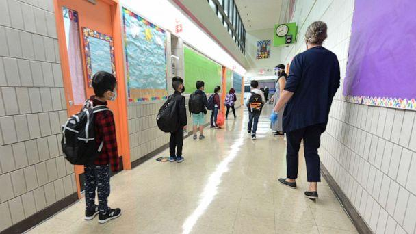 PHOTO: Students line up before walking into class on a day of in person at Yung Wing School P.S. 124, Oct. 1, 2020, in New York City. (Michael Loccisano/Getty Images)