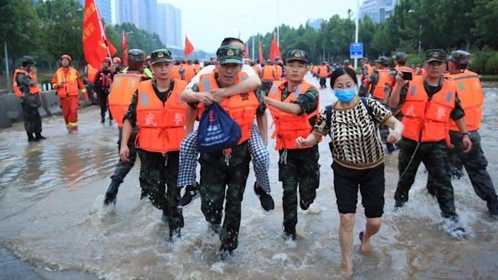 Rescuers evacuate people from a hospital where about 3,000 people were trapped by the flood in Zhengzhou