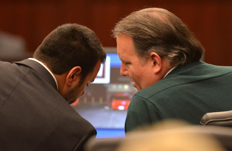 Defense attorney Cory Strolla, left, talks with Michael Dunn during the first day of Dunn's trial in Jacksonville, Fla., Thursday Feb. 6, 2014. Michael Dunn is charged in the shooting death of Jordan Davis who was outside a Jacksonville store with friends in November 2012. (AP Photo/Bob Mack, Pool)