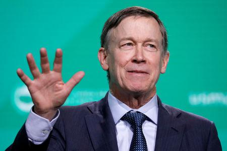 FILE PHOTO:    Former Gov. John Hickenlooper (D-CO) speaks at the United States Conference of Mayors winter meeting in Washington, U.S., January 24, 2019. REUTERS/Yuri Gripas/File Photo