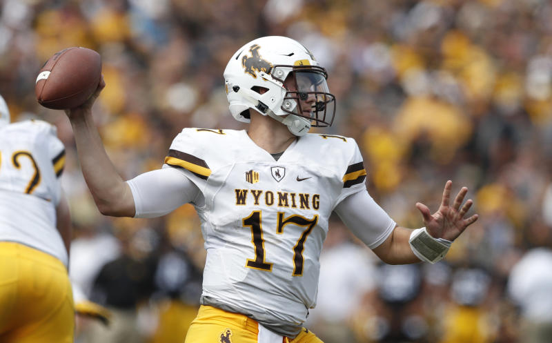 Wyoming quarterback Josh Allen will likely be drafted early in the first round of the NFL draft, perhaps first overall. (AP)