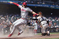 Philadelphia Phillies' Alec Bohm, left, scores past San Francisco Giants catcher Buster Posey during the seventh inning of a baseball game in San Francisco, Saturday, June 19, 2021. (AP Photo/Jeff Chiu)