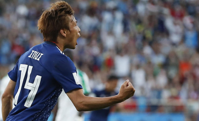Japan's Takashi Inui celebrates after he scored his side's first goal during the group H match between Japan and Senegal at the 2018 soccer World Cup at the Yekaterinburg Arena in Yekaterinburg , Russia, Sunday, June 24, 2018. (AP Photo/Natacha Pisarenko)