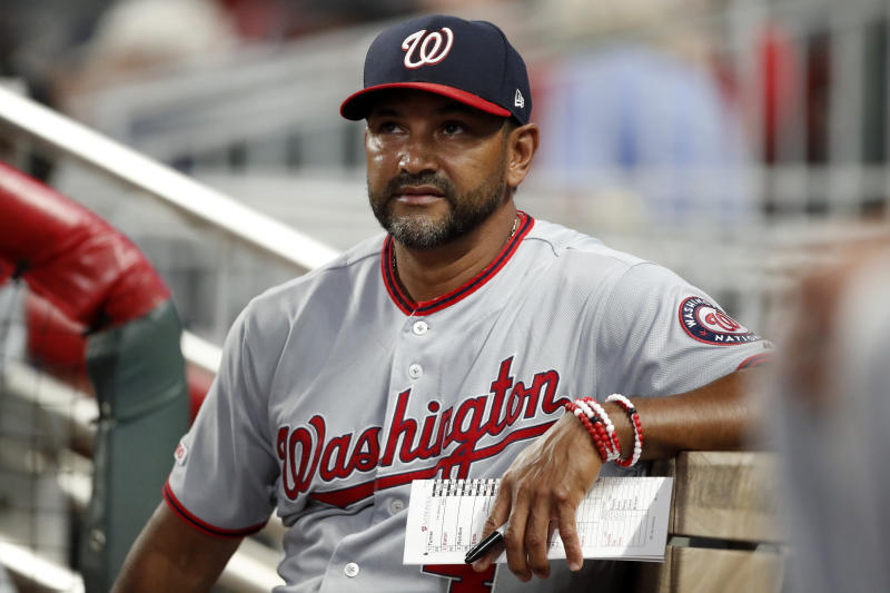 Washington Nationals manager Dave Martinez (4) watches from the dugout during a baseball game against the Atlanta Braves Thursday, July 18, 2019, in Atlanta. (AP Photo/John Bazemore)
