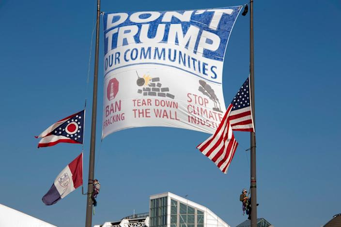 <p>Female activists raise a banner from the flag poles outside the Rock and Roll Hall of Fame during the Republican National Convention in Cleveland on July 19, 2016. (Photo: Reg Mizell/Handout via REUTERS)</p>