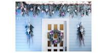 <p>A pastel blue home ditches the traditional Christmas colors for complementing pink and purple accents. </p>