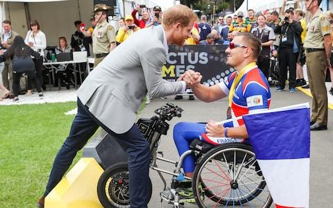 Prince Harry, Duke of Sussex shaking hands with french competitor during day two of the Invictus Games in Sydney - Credit: Chris Jackson/Getty Images