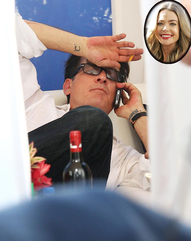 """You might think of Charlie Sheen as just plain crazy, but at one point he was simply crazy in love ... with wife Denise Richards, and decided to add to his tattoo collection by getting Denise's first name written across the inside of his left wrist. Fast forward to today, several years after their divorce, and his right wrist now boasts the letter C (a tribute to his favorite person, we're assuming) and over on the left, """"Denise"""" has been replaced with the one word Charlie will forever be linked to, tattoo or not: winning."""
