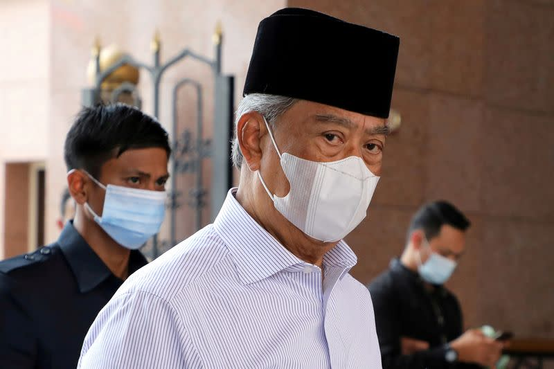 FILE PHOTO: Malaysia's Prime Minister Muhyiddin Yassin wearing a protective mask arrives at a mosque for prayers, amid the coronavirus disease (COVID-19) outbreak in Putrajaya
