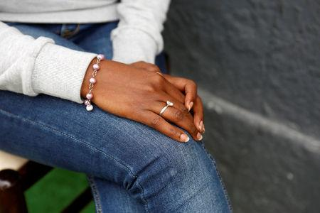 The hands of Eritrean migrant Ruta Fisehaye are seen as she poses for a photograph in Catania, Italy, May 11, 2016. REUTERS/Antonio Parrinello