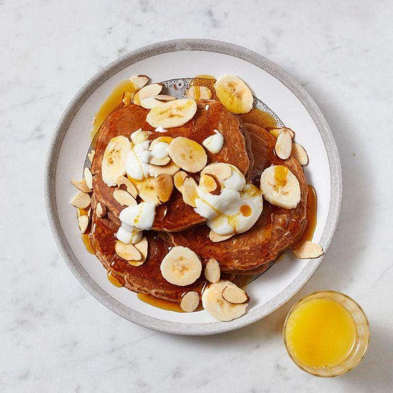 """<p>These plant-powered pancakes, which skip the syrup and instead get a natural sugar boost from bananas, honey, and nuts, have a seal of approval from Jones. A stack of these things is especially nice if find yourself craving sweet snacks with your caffeine.</p><p><strong><em><a href=""""https://www.prevention.com/food-nutrition/recipes/a34465332/peanut-butter-banana-pancakes-recipe/"""" rel=""""nofollow noopener"""" target=""""_blank"""" data-ylk=""""slk:Get the recipe »"""" class=""""link rapid-noclick-resp"""">Get the recipe »</a></em></strong></p>"""