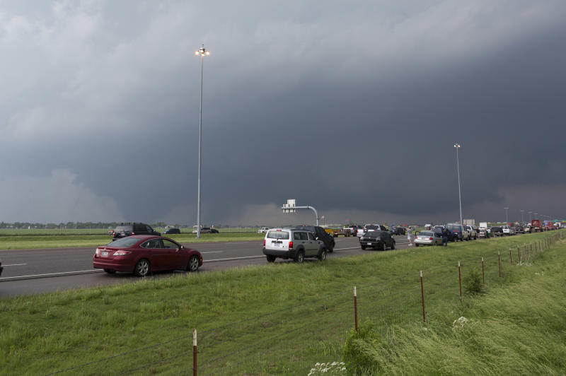 A tornado moves through Moore, Okla. as northbound traffic on Interstate 35 stops at Indian Hills Road on Monday, May 20, 2013. (AP Photo/Alonzo Adams)