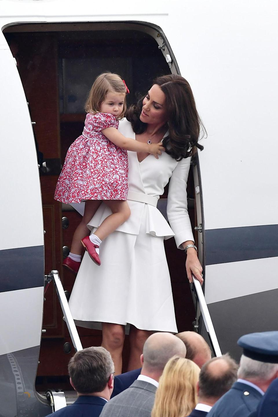 <p><b>The Duchess arrived in Warsaw in an all-white Alexander McQueen look. <br><em>[Photo: PA]</em> </b></p>