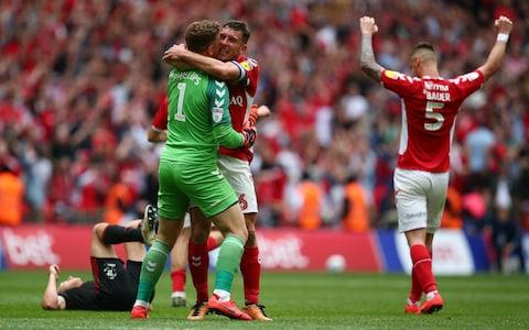 Dillon Phillips, Patrick Bauer and Jason Pearce of Charlton Athletic celebrate victory at the final whistle during the Sky Bet League One Play-off Final - Credit: Charlie Crowhurst/Getty Images