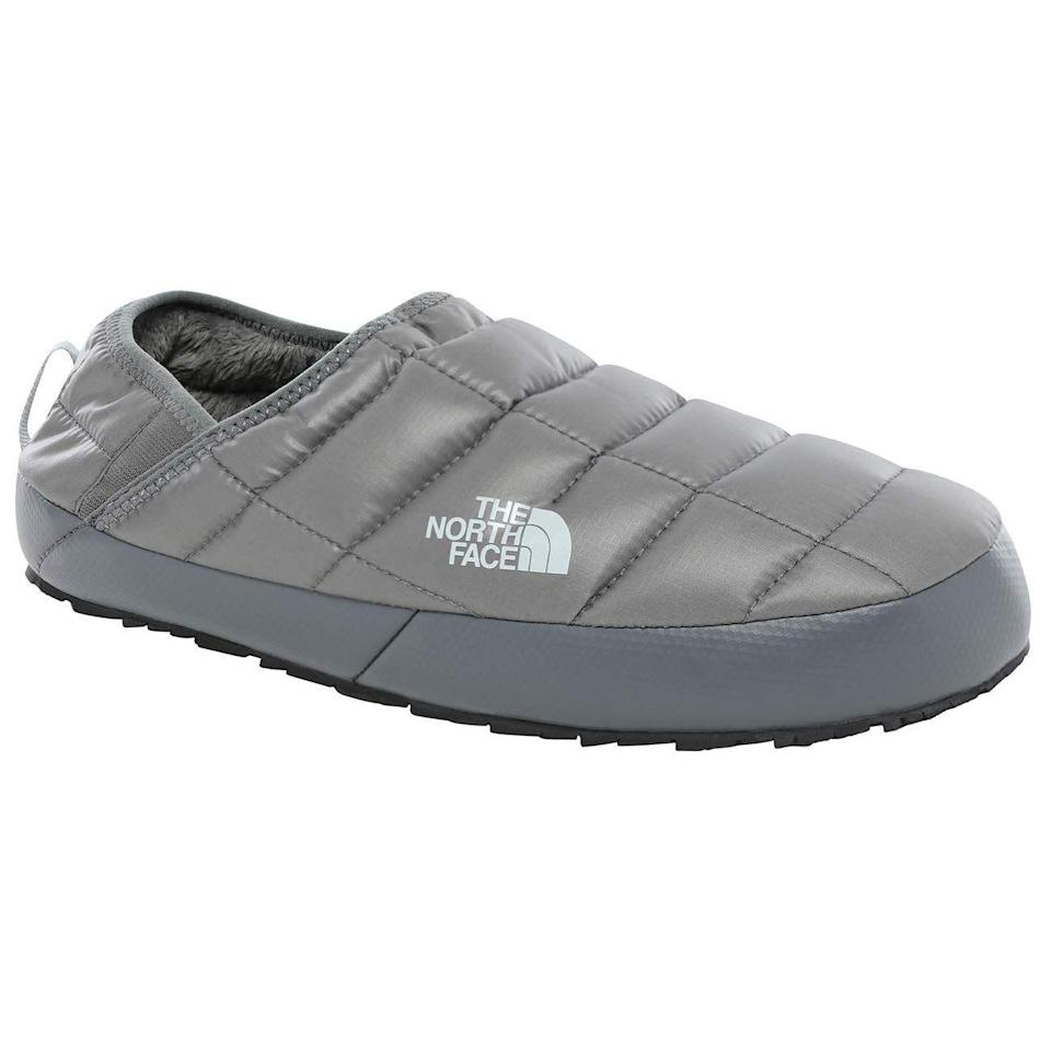 """<p><strong>The North Face</strong></p><p>amazon.com</p><p><strong>$131.21</strong></p><p><a href=""""https://www.amazon.com/dp/B07N992BFS?tag=syn-yahoo-20&ascsubtag=%5Bartid%7C2140.g.25752244%5Bsrc%7Cyahoo-us"""" rel=""""nofollow noopener"""" target=""""_blank"""" data-ylk=""""slk:Shop Now"""" class=""""link rapid-noclick-resp"""">Shop Now</a></p><p>Here's one of the top Valentine's Day gifts for guys, and it's pretty obvious why: He can channel surf in these slippers, then step outside without taking them off. These babies have water- and slip-resistant treads.</p>"""