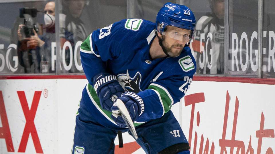 VANCOUVER, BC - MARCH 08:  Alex Edler #23 of the Vancouver Canucks shoots the puck during NHL hockey action against the Montreal Canadiens at Rogers Arena on March 8, 2021 in Vancouver, Canada. (Photo by Rich Lam/Getty Images)