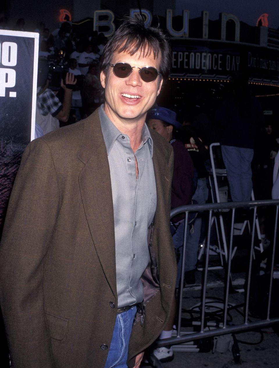<p>Bill Paxton, who starred in one of '96's other box office hits, <em>Twister</em>, made it to the <em>Independence Day</em> premiere in—a silk shirt?</p>